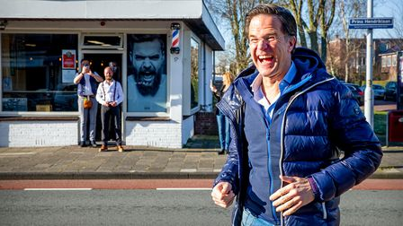 A buoyant Mark Rutte visits his hairdresserin Leidschendam after lockdown, during campaigning for the elections