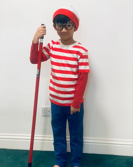 Year 1 student Zac Poon from Grafton Primary School in Islington dressed up as Wally from the book series Where's Wally?