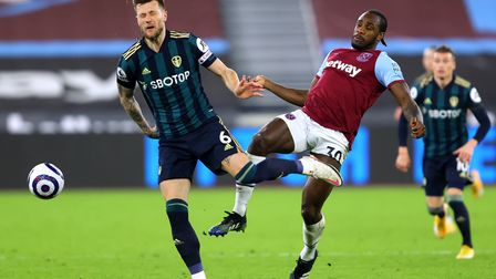 Leeds United's Liam Cooper (left) and West Ham United's Michail Antonio fight for the ball during t