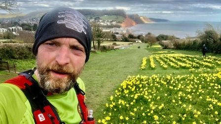 Ross Walton by the daffodils who did 4 laps/15 miles