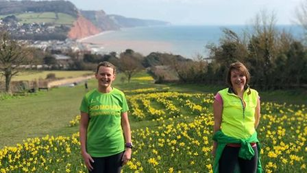 Cheryl Boulton and Susan Reeve by the daffodils