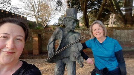 Beccy Johnson and Tracy Scannell with the fiddler, one of the landmarks