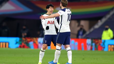 Tottenham Hotspur's Harry Kane (right) celebrates scoring their side's fourth goal of the game with