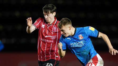 Lincoln City's Conor McGrandles (left) and Swindon Town's Scott Twine battle for the ball during the