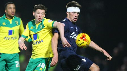 Conor McGrandles of Norwich and John Marquis of Millwall in action during the Sky Bet Championship m