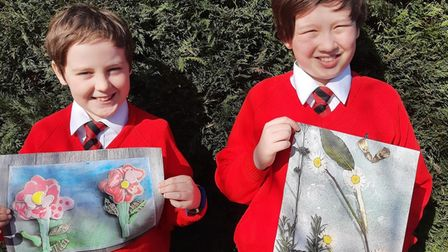 Zac Harcombe and Thomas Johnston, two year 5 pupils with their flower art inspired by Yuval Sommer's Big Book of Blooms.