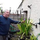 John Marks of Ipswich, who has died aged 69, in his garden