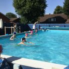Children learning to swim in Meldreth Primary School's pool.
