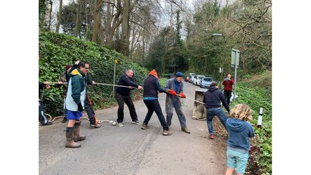 Tug-of-war team clearing dumped rubbish
