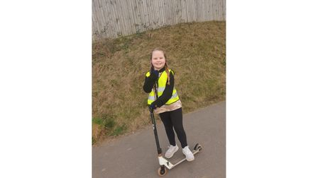 Nine-year-old girl on scooter