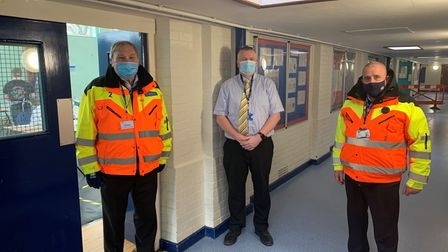 Norwich City football stewards have been helping with the pupil coronavirus testing programme at City of Norwich School.