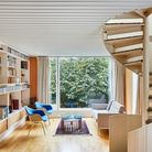 Mid century property with spiral staircase and blue chairs