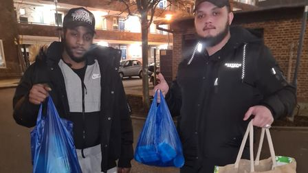 Zach Lee and Josh Walker delivering bags of essential food to vulnerable families.