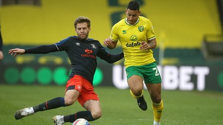 Martin Cranie of Luton Town and Onel Hernandez of Norwich in action during the Sky Bet Championship
