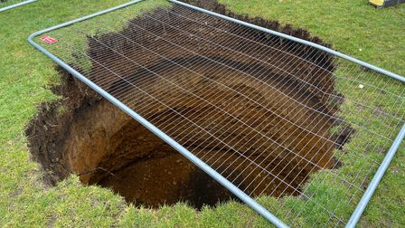 A sinkhole has appeared in the park on Frere Road, Norwich.