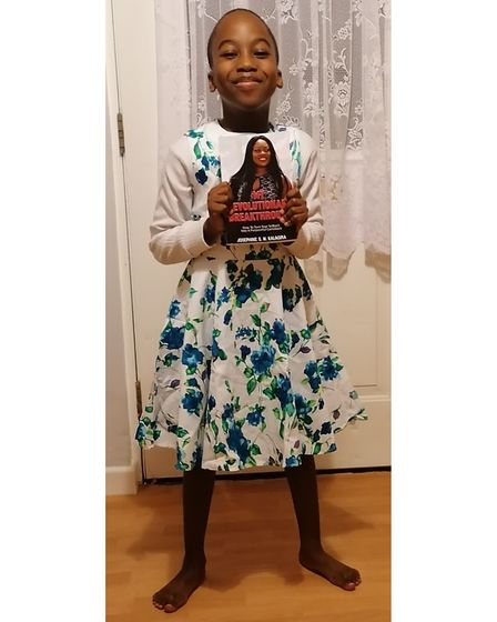 Jayden saved up to buy a dress for his costume and took a copy of his mum's book in to school on World Book Day