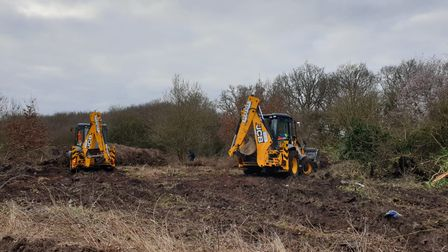 Diggers clearing a woodland at Copthorne Gardens in Hornchurch.