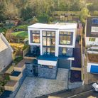 Blue-grey detached architect-designed house in Hillside Road Portishead with three levels and huge windows