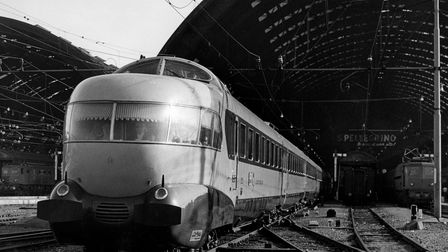 One of Italy's distinctive Settebello services– complete with observation lounge and the front– pulls out of Milan's...