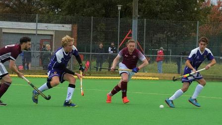 Guy Flynn (second from left) and George Pitfield (right) in action for Saffron Walden Hockey Club