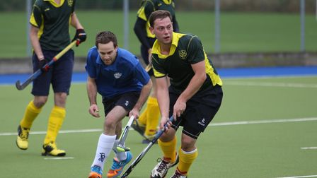 Alex Wareham comes away with the ball for Letchworth Hockey Club