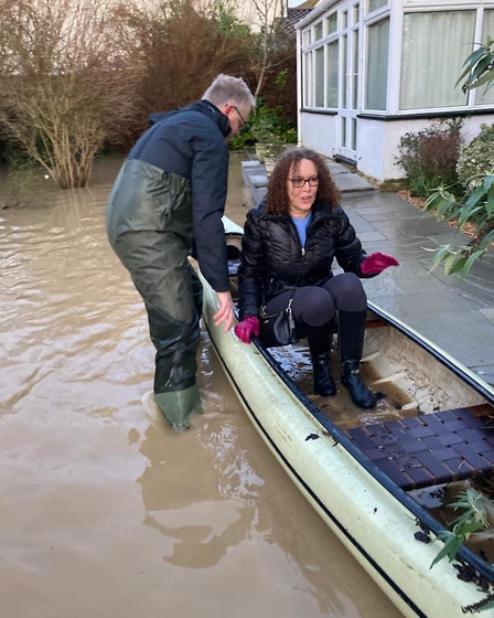Two residents kayaking in Great Staughton last Christmas Eve