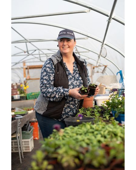 Jo Hull tending to her seedling in the polytunnel. Picture: SARAH LUCY BROWN