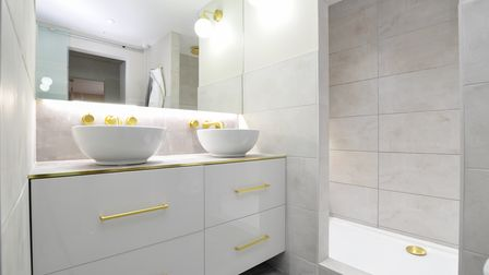 The en-suite to the master bedroom of the former post office in High Street Claverham has his and hers basins on top of a...