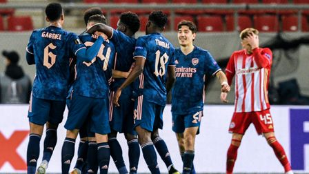 Arsenal players celebrate after team-mate Martin Odegaard (blocked) scores their side's first goal o