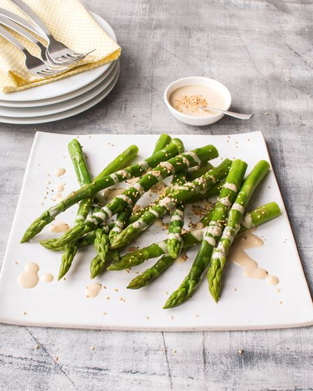 Blanched asparagus with lemon and tahini dressing