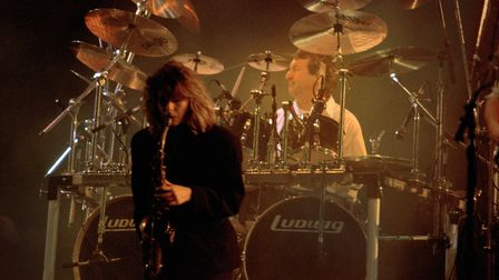 Sax player Candy Dulfer and Pink Floyd drummer Nick Mason on stage at Knebworth in 1990.