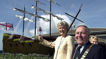 Cyril and Jean Webb with the galleon of flowers 3D floral sculpture outside Felixstowe Leisure Centre