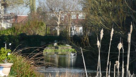 The now derelict bridge over the lake to Marshalls House