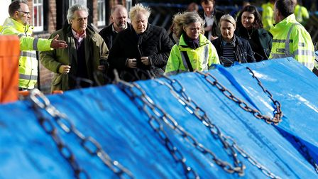 Prime Minister Boris Johnson eventually visited flood victims in Bewdley in Worcestershire to see re