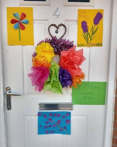 Abbie Hann-England decorated her front door in bright coloured flowers to mark the run up to Mother's Day for St Albans...