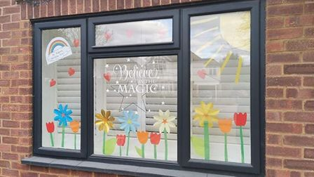 Jamie and Sophie Bowler's 'Believe in the Magic' flower window forSt Albans Rainbow Trail's Mother's Day trail