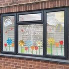 Jamie and Sophie Bowler's 'Believe in the Magic' flower window for St Albans Rainbow Trail's Mother's Day trail