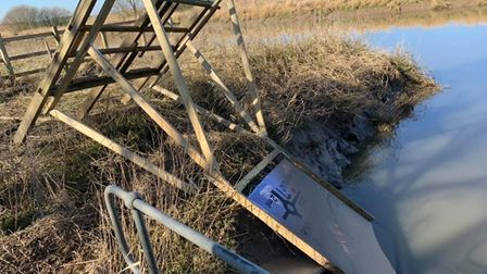 Herbie Hut promotional board ripped apart and pushed towards the river