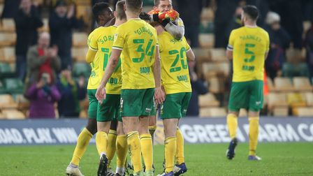 Norwich City players celebrate victory over Sheffield Wednesday