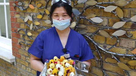 And here's one I made earlier! - St John's Hospice healthcare assistant Mylen with chicks knitted by volunteers