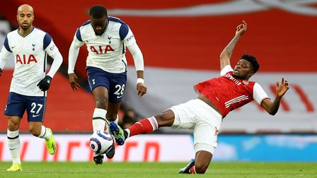 Tottenham Hotspur's Tanguy Ndombele (left) and Arsenal's Thomas Partey battle for the ball