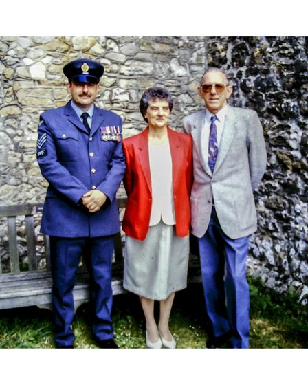Army veteran in uniform with his parents