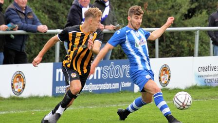 Clevedon Town's Elliott Nicholson in action against Axminster Town