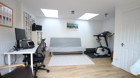 There is a home office/gym at the bottom of the garden.