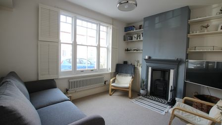 A feature of the living room is its wood burning stove.