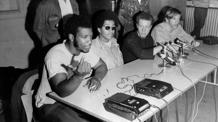 Fred Hampton, left, chairman of the Black Panthers, speaks during a press conference with the Young