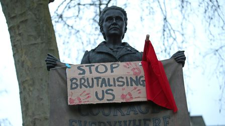 A placard on the statue of suffragist leader Millicent Fawcettin Parliament Square