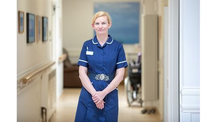 Hospice nurse in bright blue uniform