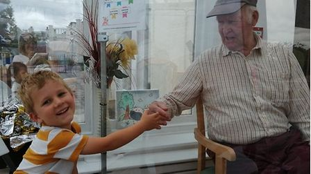 Noah Loosemore, aged four, finally caught up with his lockdown mate George Whigham, 82.