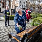 Councillors put down flowers outside the Town Hall. From left: Cllr Richard Watts, Cllr Sue Lukes, and Cllr Kaya...